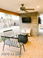 CUSTOM COVERED PATIO WITH PAVERS AND ENTERTAINMENT SPACE