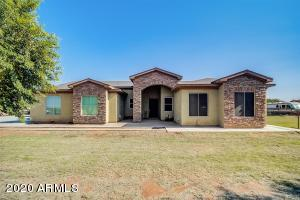 Single level horse property. 4 bedroom/2.5 bathroom home sits on 1.25 acres with irrigation.