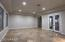 Living room/Dining room with entrance to interior courtyard