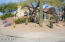 Home is situated on a corner lot with beautiful desert landscaping and magnificent saguaro cactus.