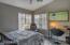 Spacious second bedroom with corner windows