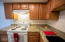 Recently updated granite countertops and beautiful cabinets.