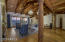 View of the magnificent wood treatments. This Great room has a vaulted T&G ceiling with trusses that run from the entertainment room through the kitchen. Oversized sliding doors open to beautiful views of the mountains, lake and the beautiful spacious backyard.