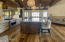 """Kitchen has oversized blue granite island with seating for 5. Bay seating around large rectangular table. Custom lighting and cabinets. Advantium Oven, 2 sinks, R/O system, 2 dishwashers. Built in microwave, Scotsman Ice machine, 36"""" Refrigerator and 36"""" Freezer."""