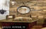 Reclaimed Wood backsplash with carved stone sink in hall powder room.