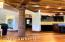 Entertainment room with one of a kind antique wood carved column from India, handmade lighting fixtures from Egypt, and one of a kind custom bar