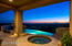 Relax in the jetted spa overlooking city lights views