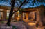 Charming courtyard entry with locally quarried stone and mature landscape