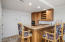 Kitchenette with bar refrigerator, sink, microwave, and generous cabinet space