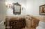 Elegant powder bathroom with antique vanity & hammered pewter sink