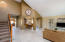 """Vaulted ceilings and 18"""" neutral tile throughout the lower level."""