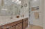 Master bathroom with dual sinks, cabinet hardware, and tile flooring.