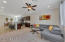Great room overlooks kitchen for open concept living. Recessed lighting and ceiling fan.