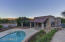 Detached Casita viewed from your over expanded pation. The guest house boasts 2 baths, a kitchenette, laundry facilities and living room. Being pool side, the guest house could double as a game room as well.