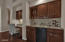 Built-in wet bar with wine Fridge right alongside the great room.