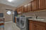 Large utility room with sink and lots of cabinet space.