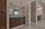 Owner's bathroom suite with two separated vanities.