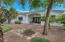 Great entertaining space under mature shade trees and covered patio.
