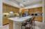 Loads of storage space, gas range, integrated refrigerator, large breakfast bar