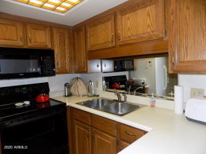 U shaped kitchen with newer appliances and good storage space