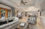 Great Room flows easily to the open kitchen, and French doors make indoor/outdoor living a breeze