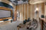 The theater or media room is a room you'll use! Great location in the house--just off the great room--so convenient to the kitchen and not tucked far away from the heart of the home.