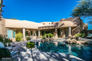 Beautiful front courtyard with heated pool.