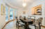 The dining room is at the heart of the home and features retractable doors to open it to the family room.