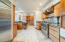 Kitchen has been updated with careful attention to honor the architecture while adding such features as a sub-zero refrigerator and a Thermador gas range.