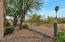 Private backyard backs to arroyo