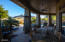 Expansive covered patio offers multiple options for outdoor dining and stunning views of Black Mountain.