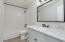 hall bath with marble countertops