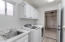 laundry room with sink & extra cabinet storage
