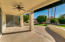 large covered patio w/extended concrete slab area