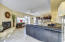 Family rooms opens to kitchen and casual dining