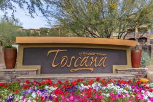 Beautiful ground floor unit. No stairs! 2 underground parking spaces come with unit! 2bed/2bath condo in 24-hour guard gated Toscana, a Resort-like community that includes a Concierge director, heated pools and spas, exercise facility, steam and sauna rooms, billiards room, and clubhouse, Steps from Desert Ridge, City North, and easy access to 101.  Granite countertop. Gas cook top and all appliances included. Brand new plank tile throughout.  Beautifully upgraded cabinetry throughout. Master bedroom walk-in closet. Large master bath. Separate shower and toilet room.
