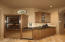 wine chiller, refrigerator drawers, Scotsman ice maker and wet bar
