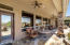 Multiple Sitting Areas On This Expansive Covered Patio. Lovely Spot To Relax And Enjoy The Desert, Views, And Backyard.