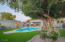 This backyard is a dream! it features a gorgeous pool, built in spa, a covered patio, artificial turf, and a private guest casita.