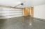 New garage door, epoxy garage floor, custom built in cabinets for storage.