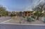Large circular driveway with Desert landscaping