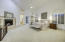 Large master bedroom with private fireplace and vaulted ceilings