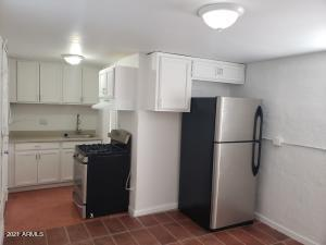 White cabinets, upgraded fixtures, counters and lighting, new stainless steel appliances