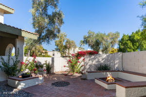Private courtyard with built-in planters, seating & firepit
