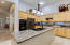 As you continue through the home you enter the open kitchen and family room.