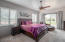 Master bedroom with private patio and view deck exit to backyard and amazing sunset views