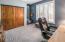 Bedroom 2 with custom natural wood closet doors.