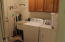 Large inside laundry with a utility sink too.