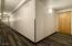 View showing main floor hallway and private hallway to Unit 4008.