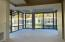 Wall of windows on 3 sides. 180 degree views of arboretum-courtyard. View from kitchen